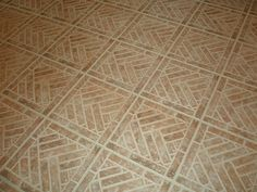 Our Lancaster Running Bond brick tiles can be laid in patterns. This is the Old Strasburg Color mix, with grout left on the surface.