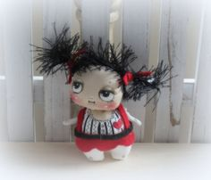 Lil Mama doll in Black white and red -hand painted .- felt skirt and ribbon in her hair . Other pics show her with her family