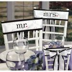 """Mr. and Mrs. Chair Sashes    White satin chair sashes are embroidered in black with mr. and mrs. punctuated with red hearts. 106"""" x 4"""", fits standard 16"""" chair backs."""