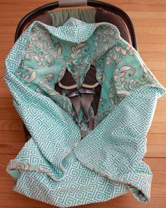 Hooded infant car seat blanket.