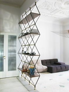 Modern living space with a geometric bookcase acting a space divider
