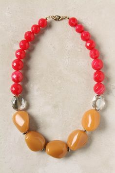 """Faceted glass and polished stones string cheery pops around your neck.  Lobster clasp  Acrylic, glass, metal  20.5""""L, 1""""W  Imported"""