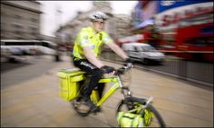 A bike paramedic, part of the cycle response unit for the London Ambulance Service, responds to a call in Piccadilly Circus