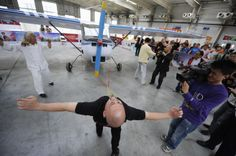 STUNTMAN DONG CHANGSHENG PULLS A 1235 LB PLANE WITH HIS EYELIDS DURING A CULTURAL FESTIVAL IN CHANGCHUN, JILIN PROVINCE ON 5/20/10. DONG, A MARTIAL ART ENTHUSIAST FOR MORE THAN 30 YEARS, PULLED THE PLANE ABOUT 16 FEET DURINGTHE PERFORMANCE.