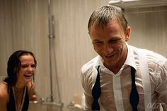Eva Green (Vesper) and Daniel Craig (Bond) share a joke on the CASINO ROYALE (2006) shower scene set.