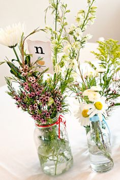 Simple summer wildflowers in jars—see more of this real wedding: http://www.mywedding.com/inspiration/real-weddings?galleryId=461#