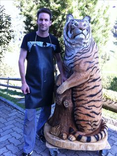 Tiger carved of wood by Melchior Trummer Switzerland