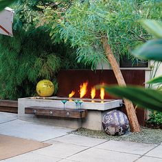 Multi-use 'firepit'. A concrete water trough doubles as a reflecting pool and an icebucket.