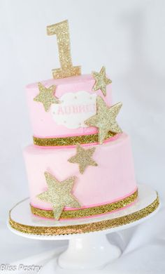 Sweet and simple with rustic iced pink buttercream and glittering gold stars