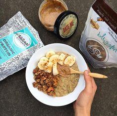 Maple Zucchini Oats {1/4 c steel cut oats, 1/2 c shredded zucchini, 2 scoops organic protein, 1/4 c almond milk, 1 tbsp cinnamon} topped w/ maple nut crunch granola, banana coins, almond butter & cinnamon