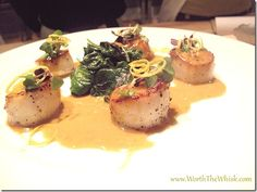 everyone needs this recipe in their arsenal - it's easy and impressive; seared sea scallops in saffron burre blanc with sautéed spinach