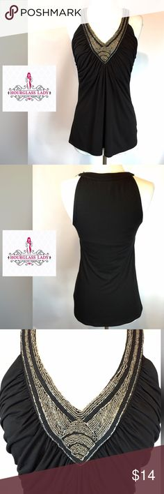 """WHBM Beaded halter tank WHBM Beaded halter tank Gathered bodice, beaded neckline Size S Bust 17"""" across, 27.5"""" long Very gently worn, note the closeup for a few tiny beads missing. Hardly noticeable, but worth mentioning 67% rayon, 29% polyester, 4% spandex ‼️PRICE FIRM UNLESS BUNDLED‼️ Create a bundle for 15% off! Thanks for looking✌️❌NO TRADES❌ White House Black Market Tops Tank Tops"""