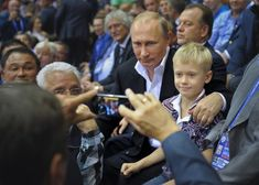 Putin looking at an iPhone.   48 Photos Of Vladimir Putin Looking At Things