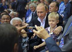 Putin looking at an iPhone.