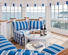 """The crisp blue & white stripes enhance the view from this great """"lookout"""" room. Via the House of Turquoise  Elizabeth B. Gillin + Falcon Industries"""