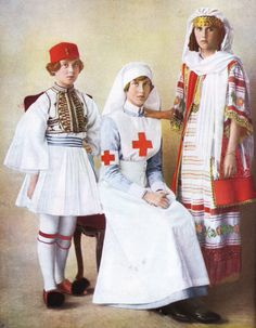 """The daughters of Grand Duchess Elena Vladimirovna in costume.  Marina is dressed as an Evzone, elite Greek soldiers known for their distinctive uniforms, Olga as a Red Cross nurse, and Elizabeth in Greek national costume.  """"[Nicholas'] three children,..."""