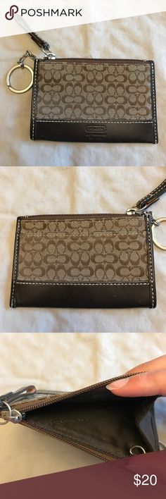 Coach Signature Mini Skinny Wallet/ID Case Signature jacquard leather trim. Zip-top closure, fabric lining. Credit card slot and attached key ring. Used, but in great condition. Coach Bags Wallets