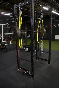 Our Rogue Westside Barbell squat racks are the center piece of our gym's equipment and training arsenal.  The holy grail of strength training is a solid rack.  The picture shows our rack set up for squatting against bands for accommodated resistance and the yellow straps are safety spotter straps made by Spud INC.  No matter where you are from, if your gym doesn't have 5 or six power racks, you're in the wrong place.
