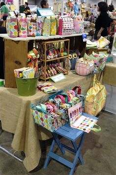 Craft table display   (buckets, wire bins, side table)