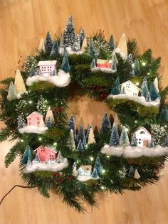 My wreath inspired by the 2014 Martha Stewart Dec. issue. Painted & glittered houses from Little Village Houses and I.M. Putz Houses and even used the tiny house from Papertrey's Make It Market Tinsel and Tag (attached 2 houses together and slightly altered the roof.