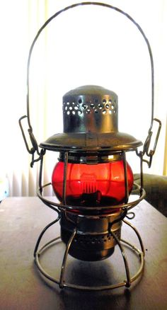Brass Railroad Lantern with Red Globe - Darn, I put my lantern in a garage sale. I better rescue it before it is sold. I didn't realize it was worth so much.