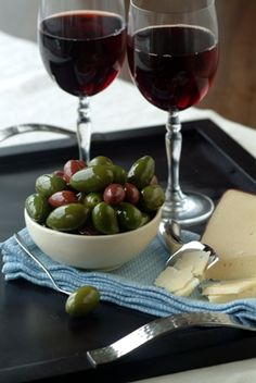 Wine + cheese + olives = an elegant way to bring friends and family together. #delallo #entertain #pairings