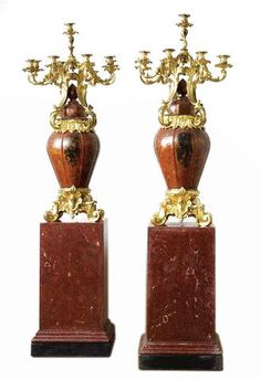 This pair of japanned metal vases with lids, adorned with ormolu bronze candelabra and feet, and pair of red scagliola stone pedestals, were designed and produced by Henri Picard, and come from a recent estate sale on the island of Corsica.  An exceptional designer, bronzier and fondeur, Picard established his firm in 1831 in Paris and is famous for creating decorative objects for the apartments of Napoleon III (1808-1873) at the Louvre.