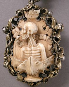 Carved ivory skeleton brooch