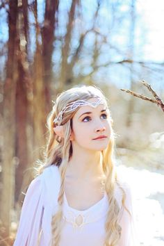 Lady Galadriel Cosplay. This is pretty good actually even though she looks a bit young to be Galadriel. Galadriel had an ancient yet still strong beauty. Looking at her you knew she had been around for a long time yet still her beauty remained timeless.-Meghan