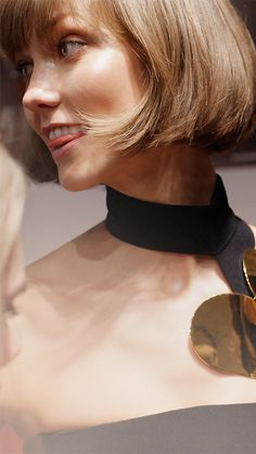 Behind the scenes at the Burberry Prorsum A/W13 show. Karlie - short bob.