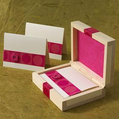 Create custom stationery for a friend by embellishing an unfinished wooden box and plain-Jane note cards with ribbon and buttons. Attach the ribbon and