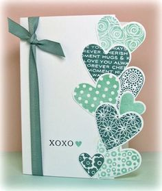 lovely handmad Valentine card ... heart prints in blue ... ragged edge made up of die cut hearts on top side ... Paper Trey Ink ...
