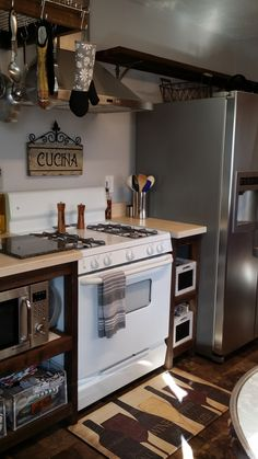 Kitchen remodel using old redwood decking material & white washed butcher block countertop