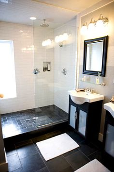 white tile on the shower walls; slate gray tile on the shower floor.