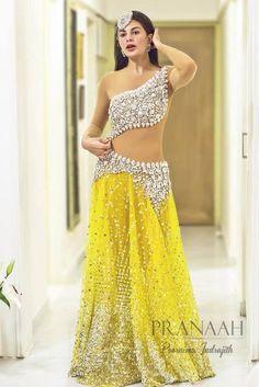 Jacqueline Fernandez dazzles in a Swarovski gown by Poornima Indrajith ,PRANAAH ! Follow Bharaty Jayaram for more wedding pins!