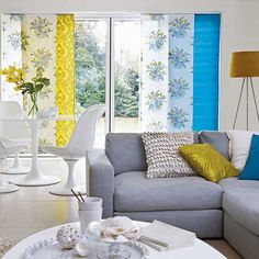 This living room features a unique palette of daffodil yellow and azure blue. These colours however are only in small splashes around the rest of the neutral white and grey theme, otherwise it would be too garish. Here however the balance is perfect and it creates a great eye catching effect.
