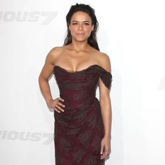 Michelle Rodriguez is beautiful in this stunning burgundy dress.