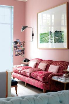 pink couch, pink walls, large scale art.