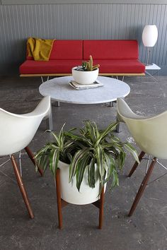 Modernica Case Study Daybed, fiberglass shell chairs and ceramic planters.