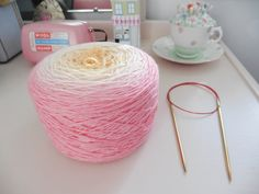 Beautiful gradient yarn cake from Wollelfe easy to be knitted into a petal shawl