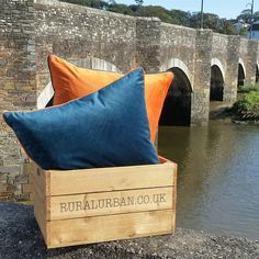 Teal velvet cushion with orange piping offset against the orange velvet cushion with teal piping.  Full collection on www.ruralurban.co.uk