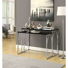 @Overstock - Incorporate extra display space into even a small area with this black console table set. Featuring a glossy finish offset by stylish chrome legs, these nesting tables are ideal for hallways, bedrooms, and other living and office spaces.  http://www.overstock.com/Home-Garden/Glossy-Black-Chrome-Metal-2-Piece-Console-Table-Set/6816626/product.html?CID=214117 CAD              373.97