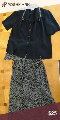 Danny and Nicole skirt and blouse Danny and Nicole skirt and blouse. Like new condition. Smoke free home. Long skirt and blouse.  Navy Blue with a flower print. Size women 14W. Danny and Nicole Skirts Skirt Sets