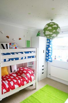 A colourful shared kids bedroom- clouds by Farg & Form.