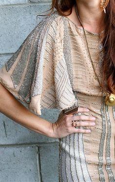 Large sleeve, beaded dress