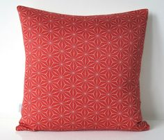 Cushion in a red geometric star pattern from by BeccaCadburyDesign, £30.00