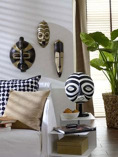 Painted wooden masks in an Africa inspired living space