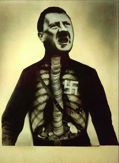John Heartfield (June 19, 1891 – 1968): Adolf the Superman: Swallows Gold and Spouts Junk. As a contributer to the DaDa movement, John Heartfield (Helmut Herzfeld) communicated his artistic vision through photomontage among the Berlin dada scene…  John Heartfield used his art to protest the violent, greedy governmental control of the Nazi party and Hitler's Third Reich. He took a satirical approach, condemning the anti-semite and the wealthy industrialist who supported the German army. He