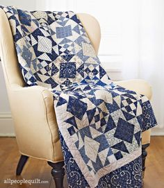 When the frosty days of winter arrive, warm your home with a dramatic  blue-and-white quilt.
