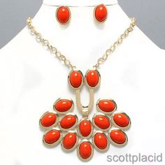 """CHUNKY ORANGE ACRYLIC GOLD TONE NECKLACE SET $20.99    * If you need a necklace extender I have them for sale in my store.*         NECKLACE: 20"""" L + 3"""" EXT    DROP: 4"""" LONG       POST EARRINGS: 1"""" LONG           COLOR: GOLD TONE"""